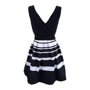 Black and white mini dress with mesh cutouts